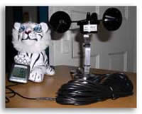 Storm Chaser windsensor on a  stormchaser's desk with stuffed animal